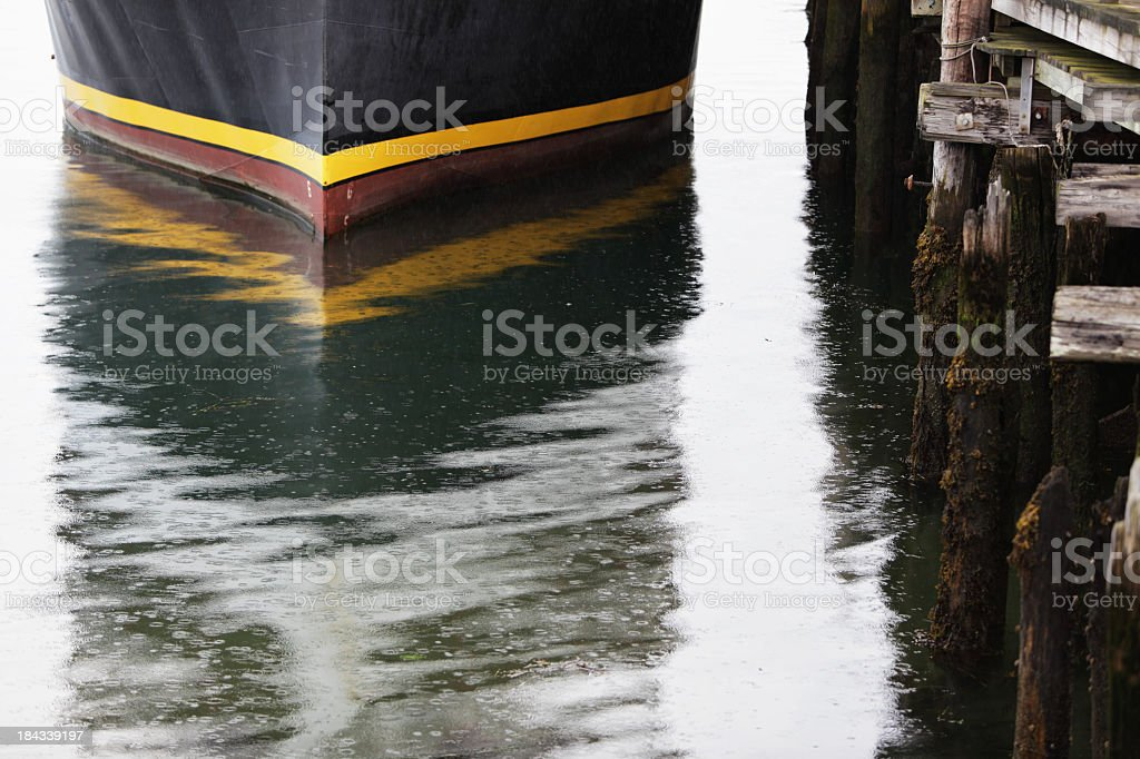 Bow of Ship Moored to Pier on Rainy Day royalty-free stock photo