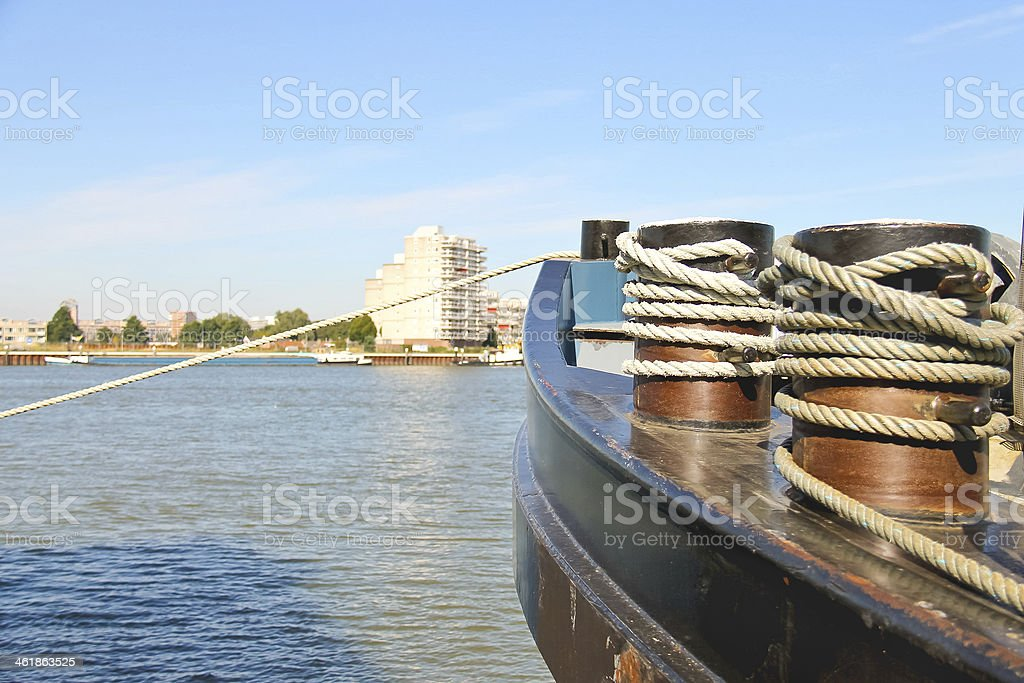 Bow of ship rope moored to the pier stock photo