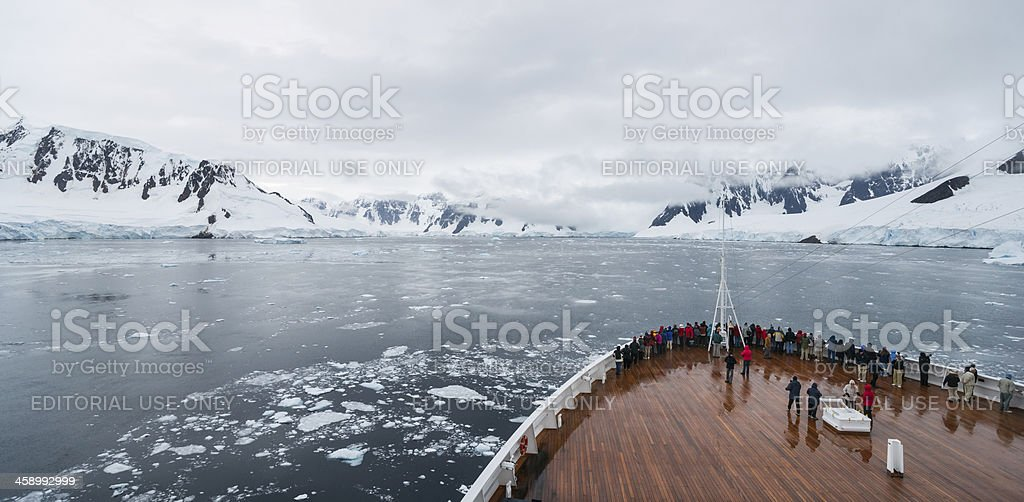 Bow of Ship with Tourists Admiring Antarctic Landscape stock photo