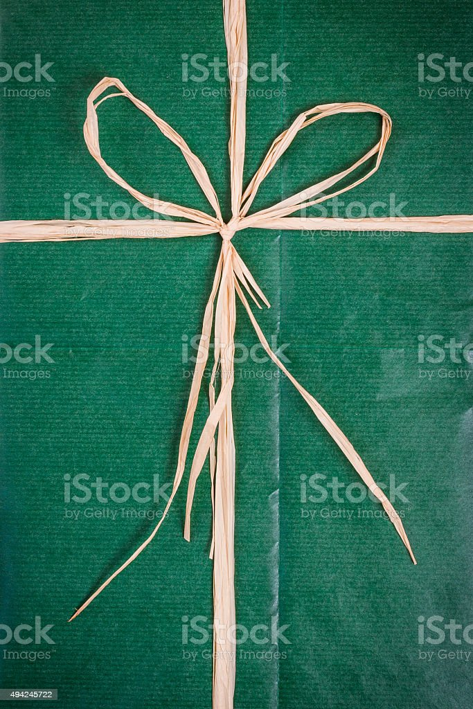 Bow on green paper package stock photo
