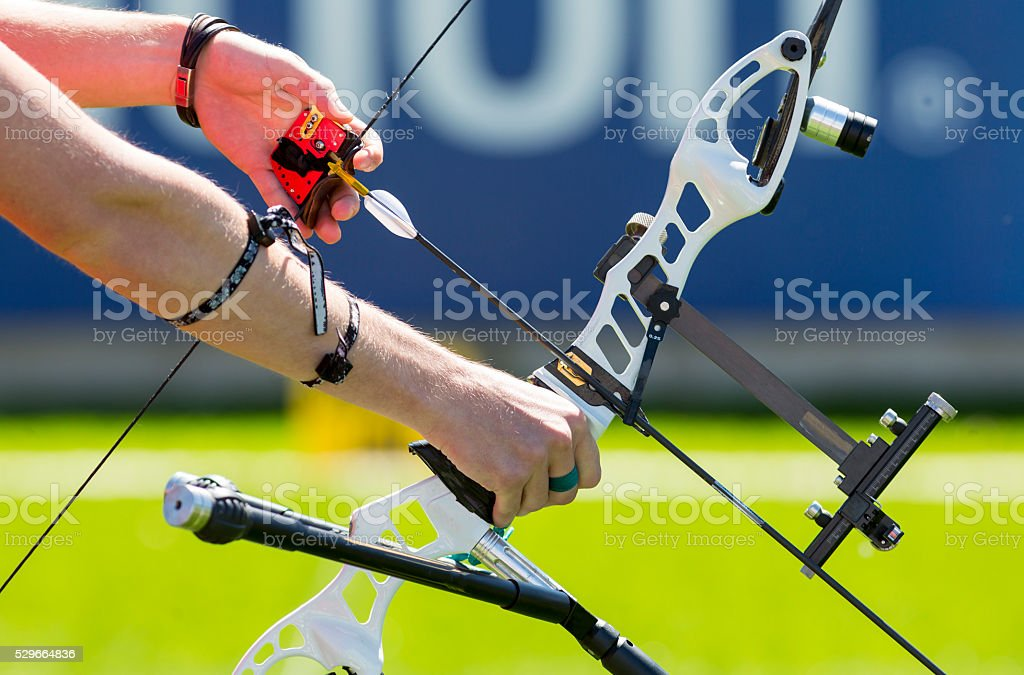 Bow shooting hands only stock photo