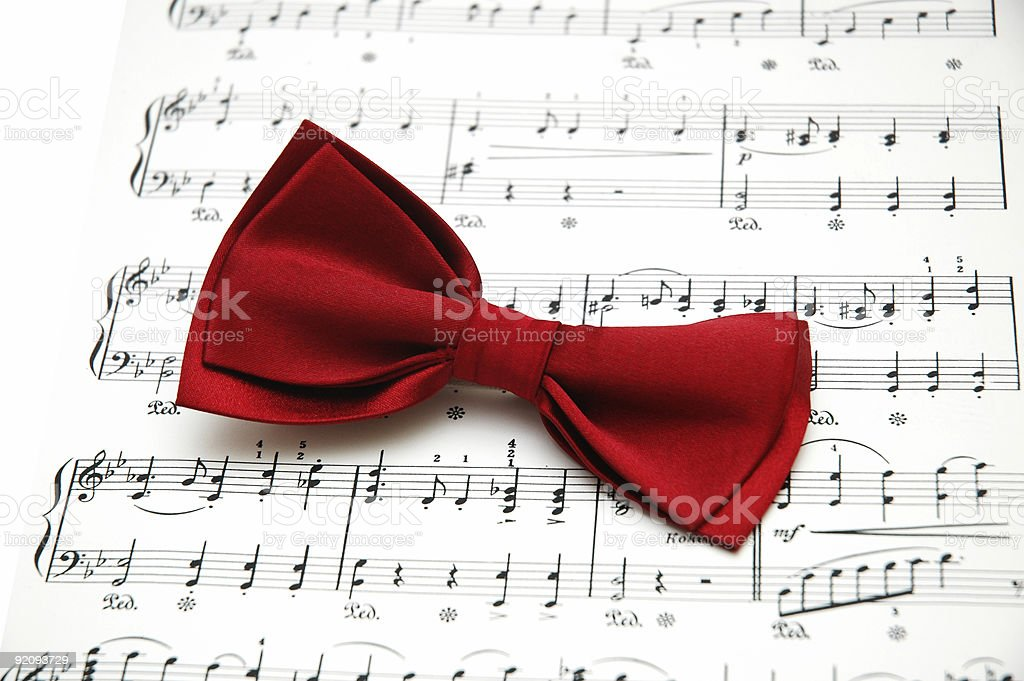 Bow tie on sheet of printed music stock photo