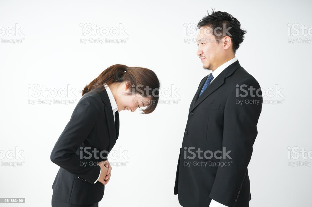 A bowing business person stock photo