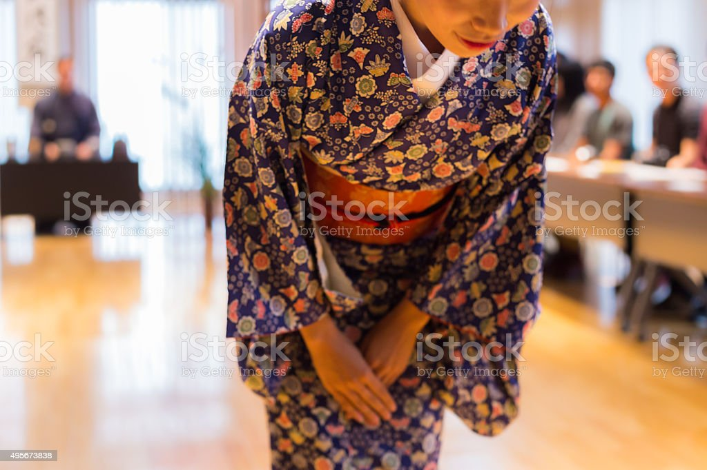 Bowing Japanese waitress stock photo