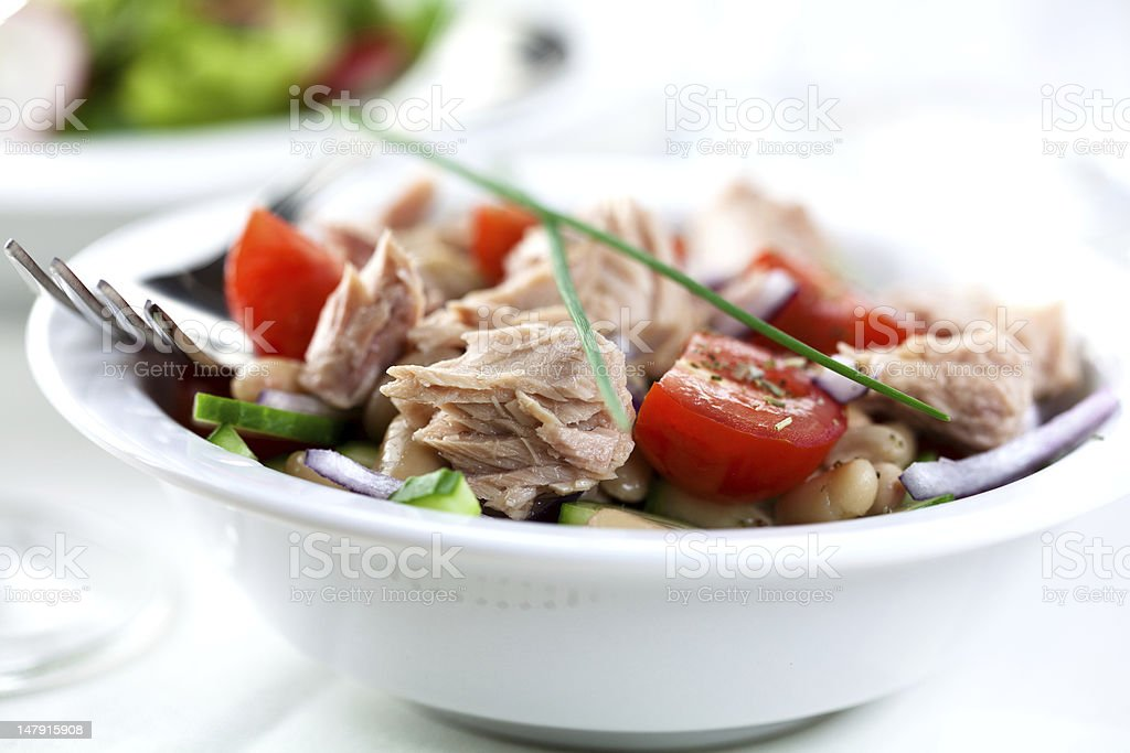 A bowl filled with tuna and vegetables stock photo