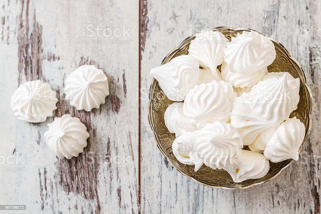 Bowl filled with vanilla meringue cookies stock photo