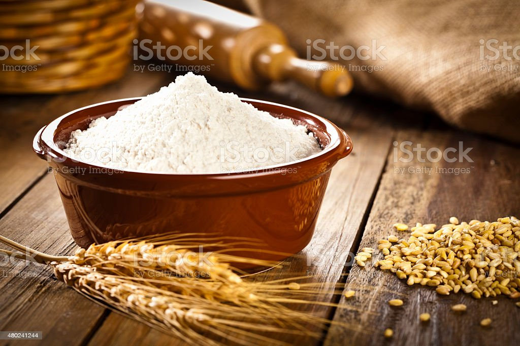 Bowl filled with wheat flour. stock photo