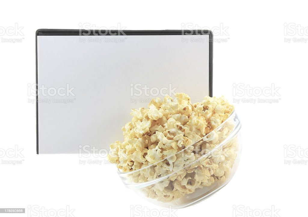 Bowl full of caramel popcorn with DVD disk . royalty-free stock photo