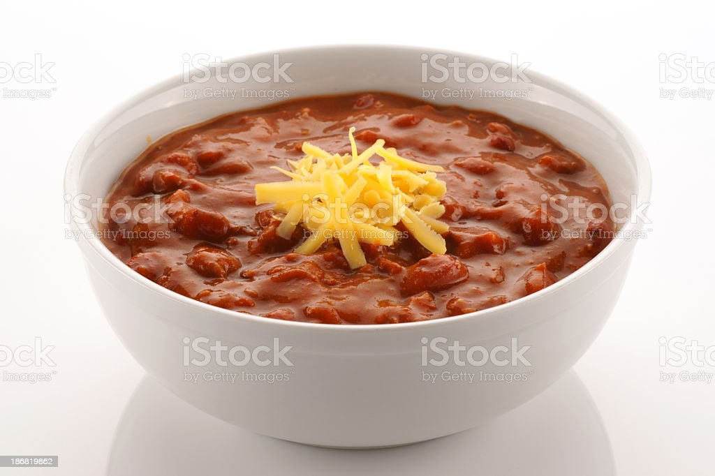 Bowl full of chili beans topped with cheddar cheese stock photo