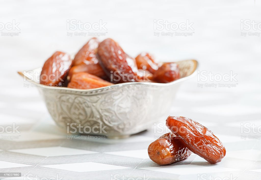 Bowl full of date fruits stock photo