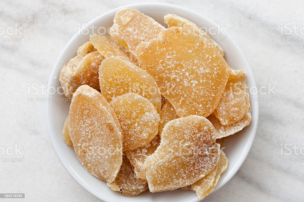 Bowl Full Of Sliced Candied Ginger stock photo