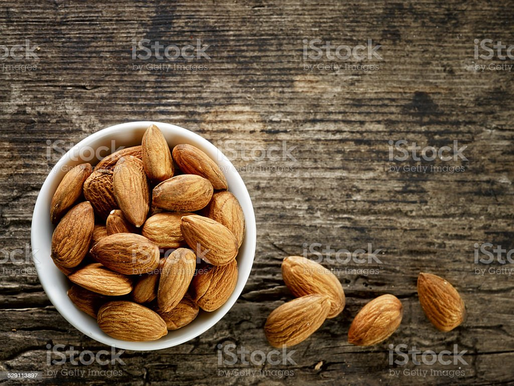 bowl of almond nuts stock photo