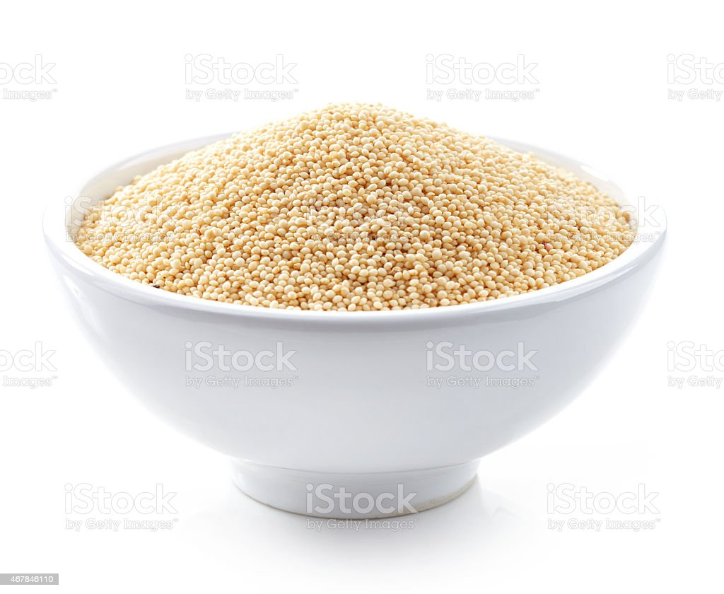 bowl of amaranth seeds stock photo
