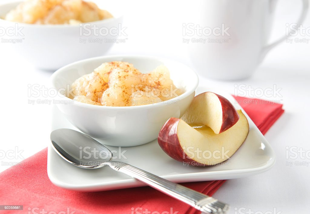 Bowl of Apple Sauce and Slices with Coffee Mug stock photo