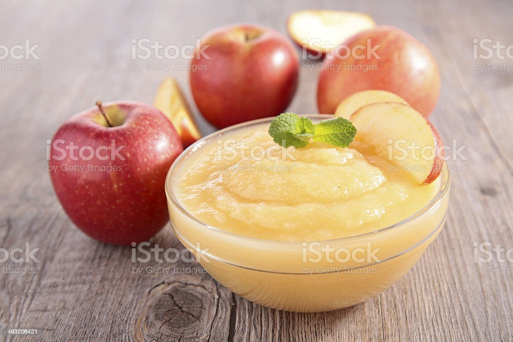bowl of apple sauce stock photo