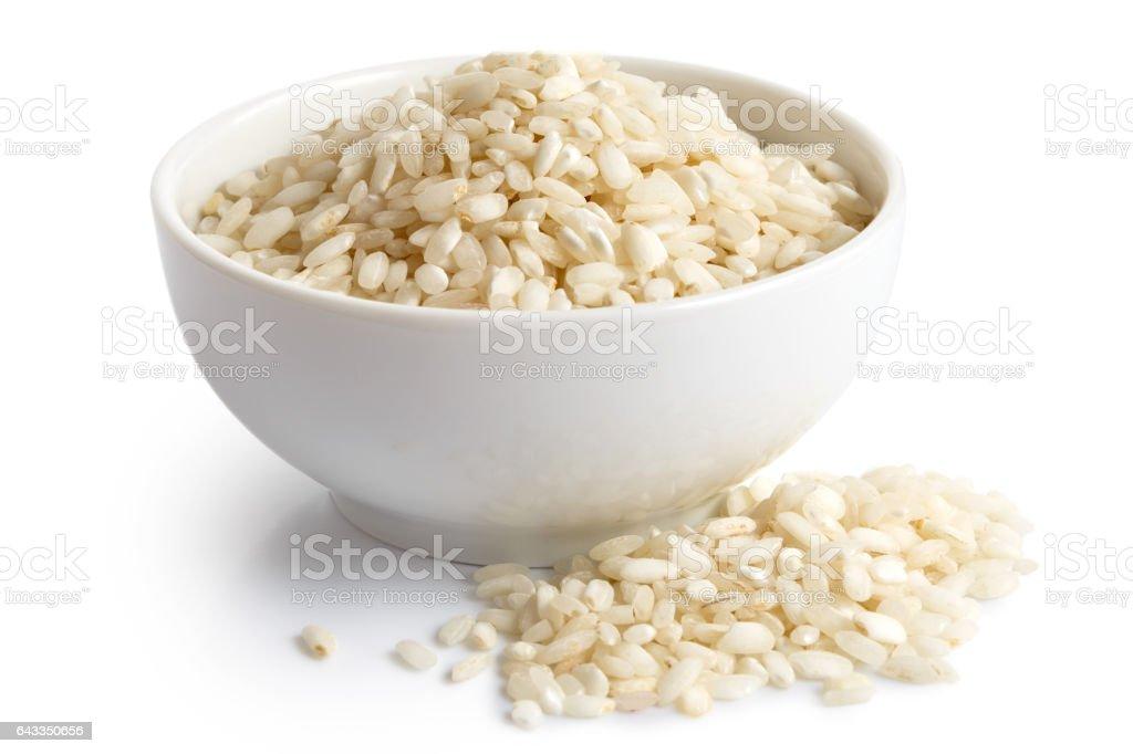 Bowl of Arborio short grain white rice isolated on white. stock photo