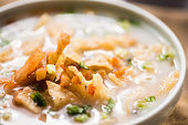 Bowl of Asian Congee, Rice Porridge, Gruel with Garnishes
