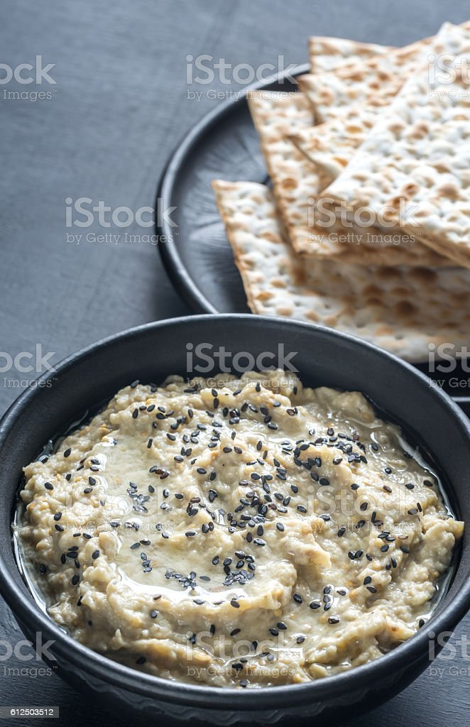 Bowl of baba ghanoush with matzo stock photo