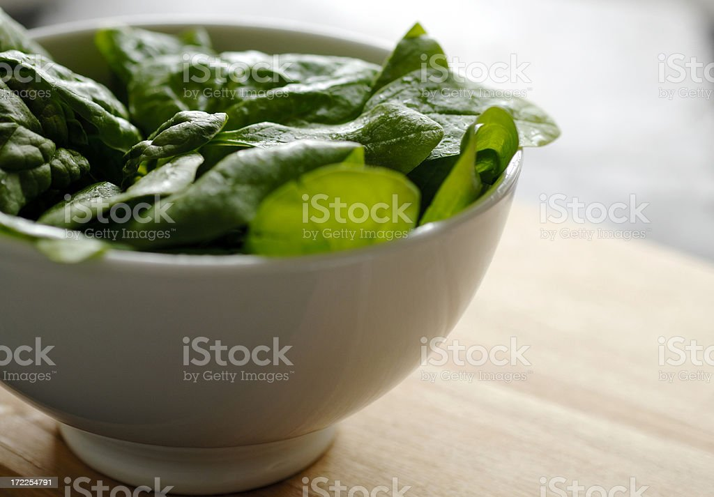 bowl of baby spinach salad leaves royalty-free stock photo