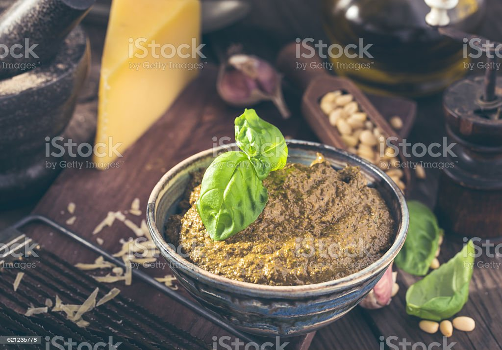 Bowl of basil pesto stock photo