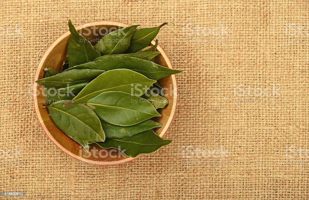 Bowl of bay leaves on burlap jute canvas royalty-free stock photo