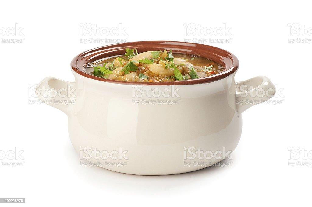 bowl of bean soup on white background stock photo