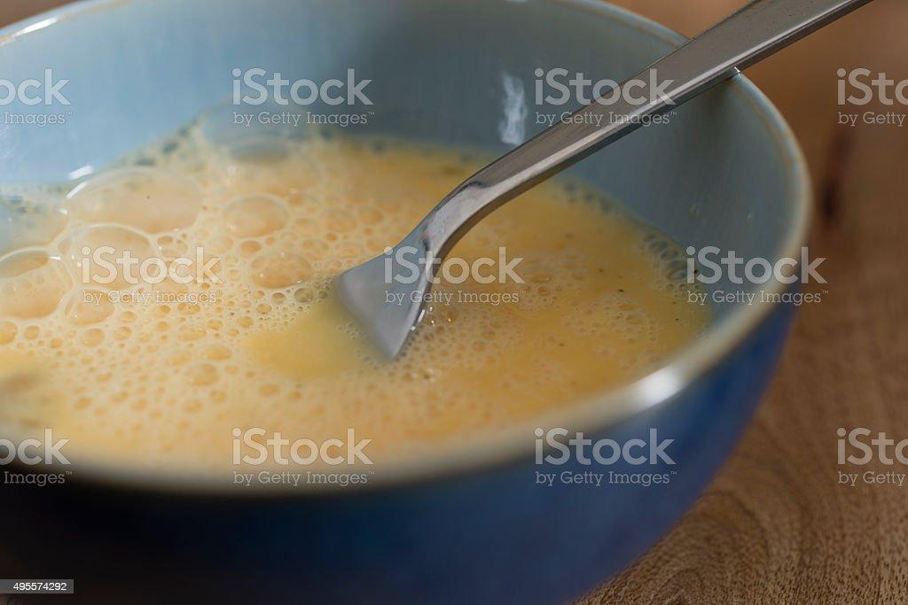 bowl of beaten egg stock photo