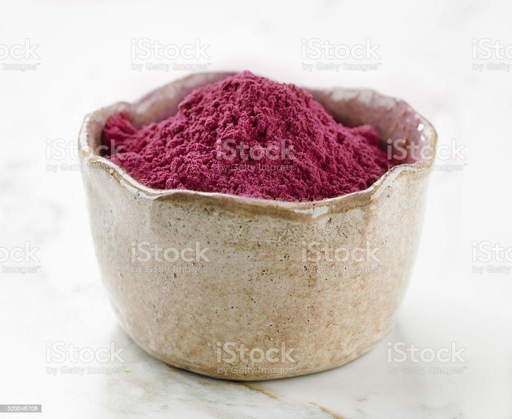 bowl of beet root powder stock photo