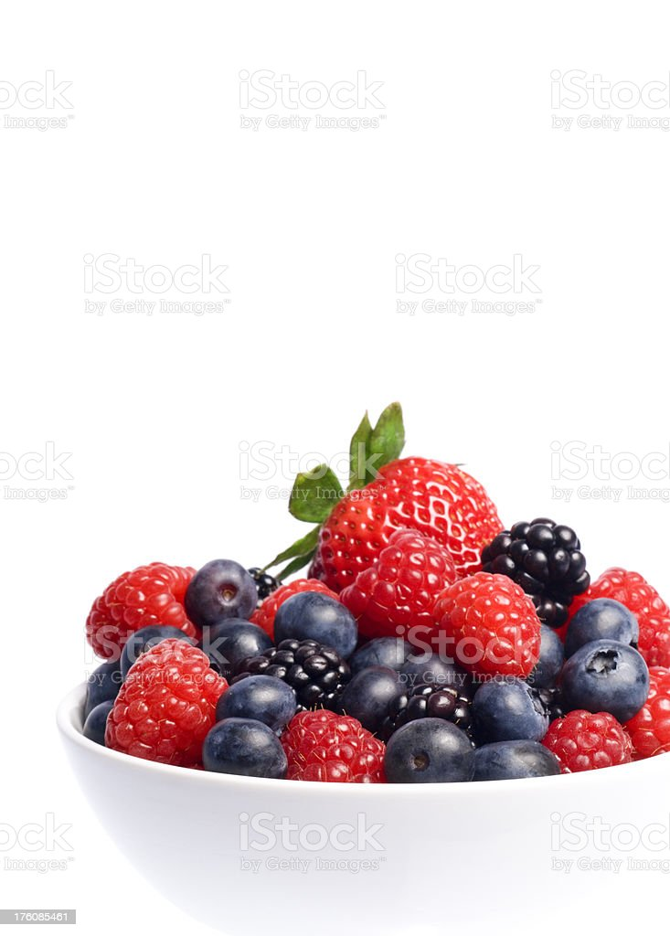 Bowl of berries over white royalty-free stock photo
