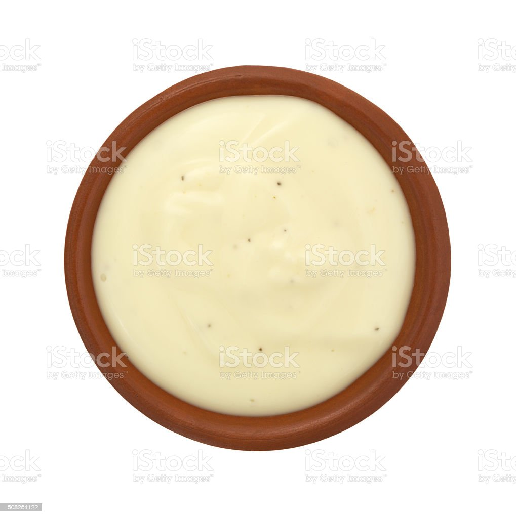 Bowl of blue cheese salad dressing on white background stock photo