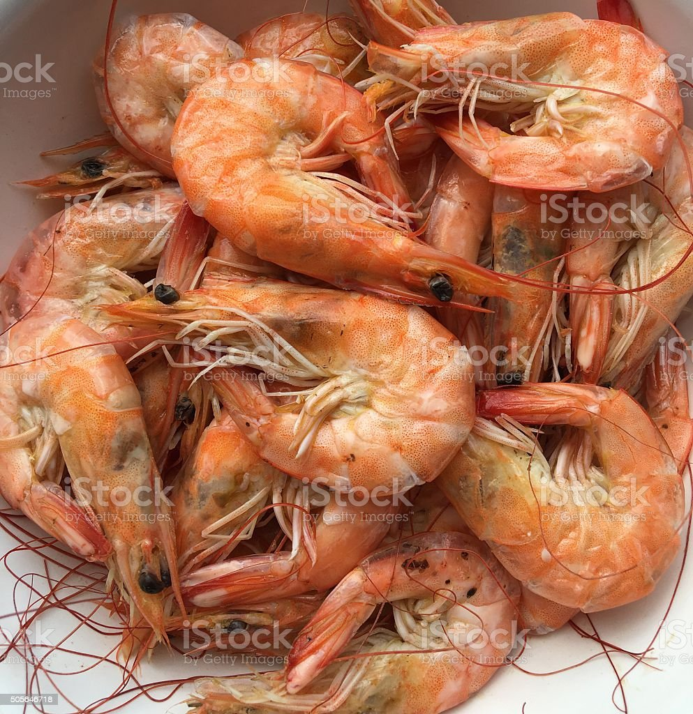 bowl of boiled shrimp stock photo