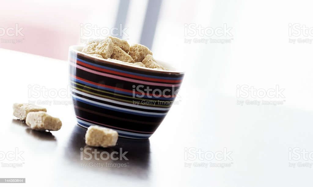 Bowl of brown sugar on a table royalty-free stock photo