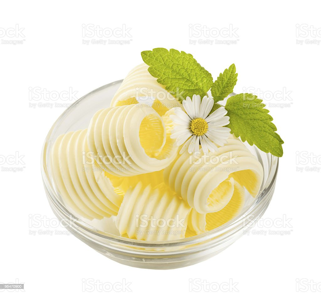A bowl of butter curls with daisies royalty-free stock photo