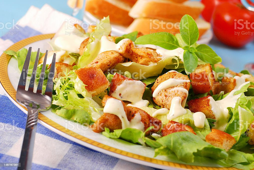 bowl of caesar salad royalty-free stock photo