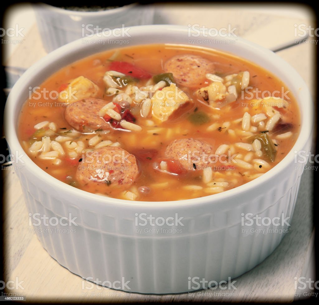 Bowl of Cajun Spicy Chicken and Sausage Gumbo Soup stock photo