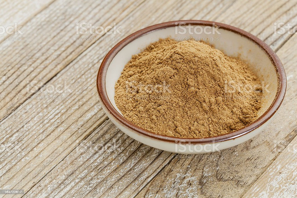A bowl of Camu fruit powder on a wooden table stock photo