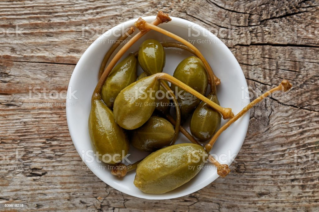 Bowl of canned capers from above stock photo