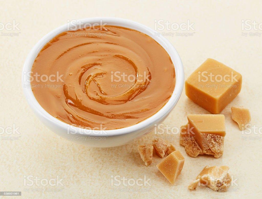 bowl of caramel stock photo