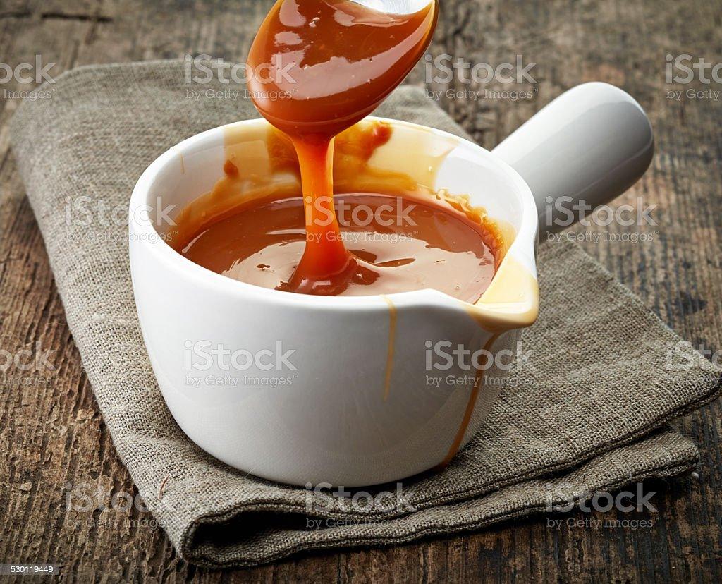 bowl of caramel sauce stock photo