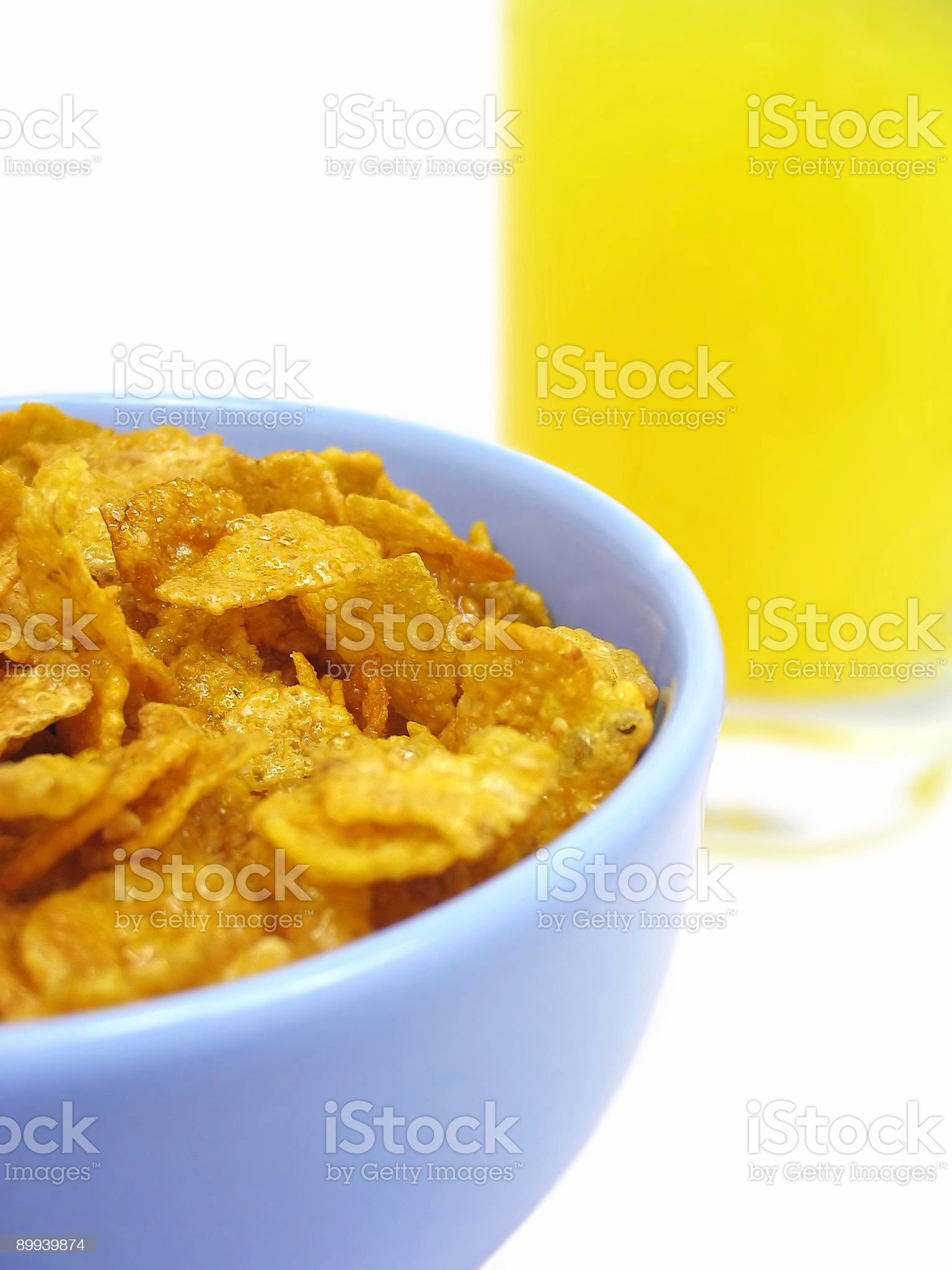 Bowl of cereal and orange juice royalty-free stock photo