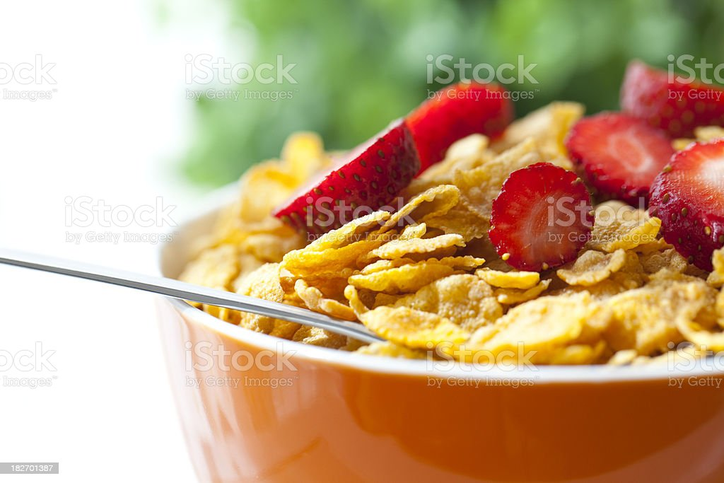 Bowl of cereal and strawberries stock photo