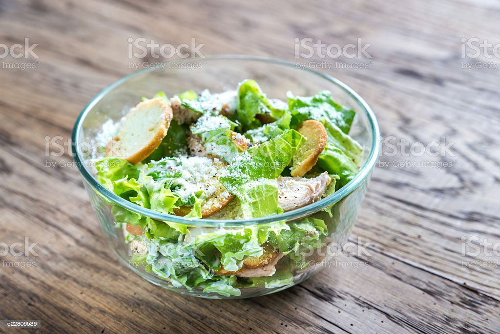 Bowl of chicken Caesar salad stock photo