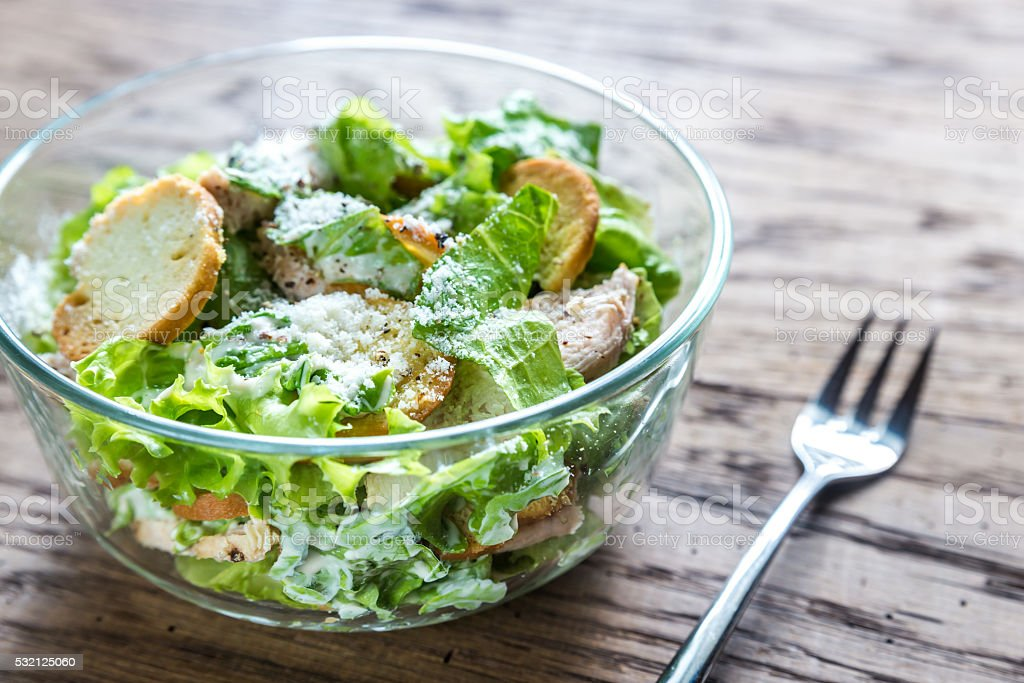 Bowl of chicken Caesar salad stock photo