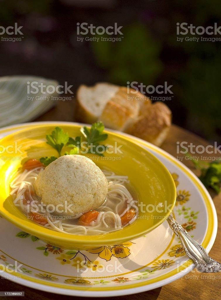 Bowl of Chicken Noodle & Matzo Ball Soup stock photo