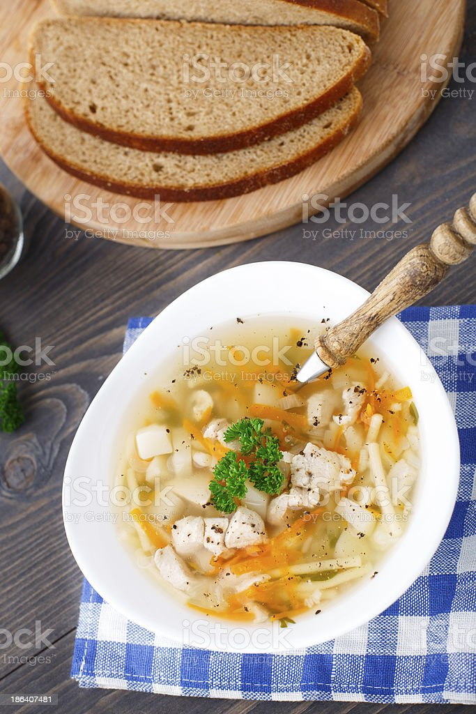 Bowl of chicken soup with vegetables and noodles royalty-free stock photo