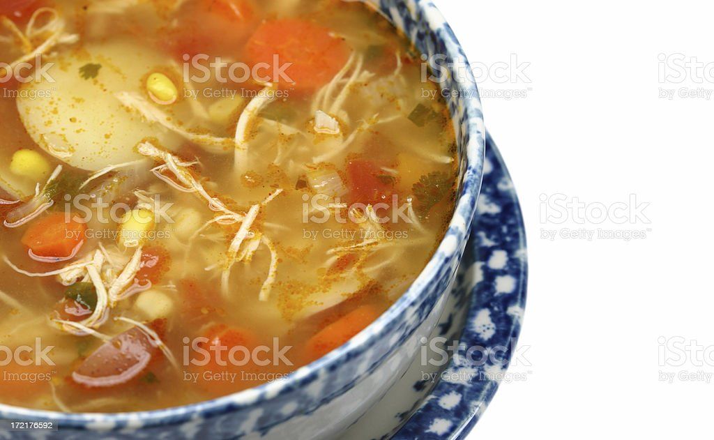 bowl of chicken vegetable soup closeup stock photo