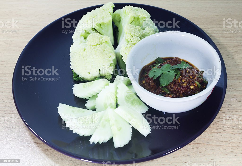 Bowl of chili con carne with ingredients stock photo