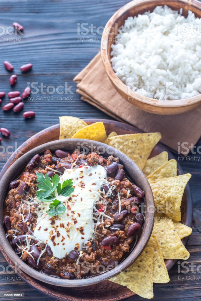 Bowl of chili con carne with white rice stock photo