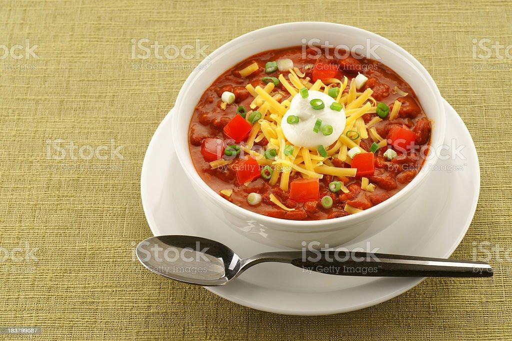Bowl of Chili on Retro Green Tablecloth stock photo