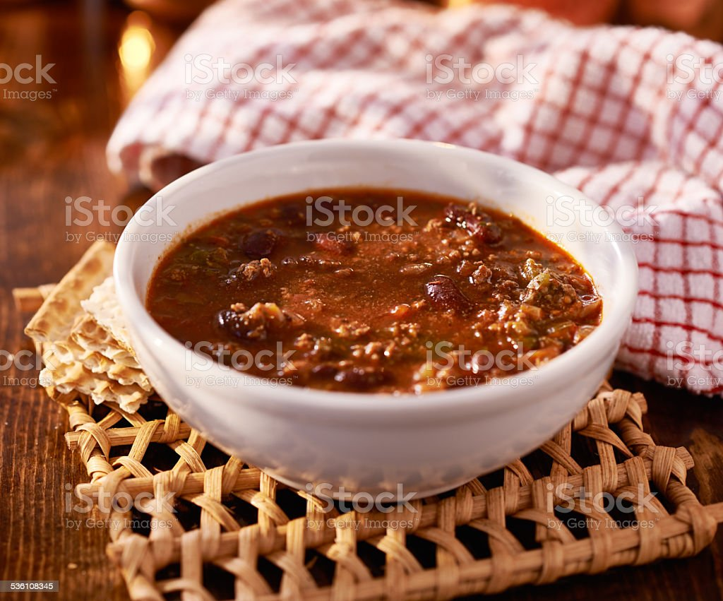 bowl of chili shot with selective focus stock photo